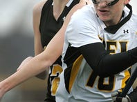 Honeoye Falls-Lima's Taylor Reed, left, cradles the ball while pressured by South Jefferson's Courtney Cavellier Friday. HF-L beat South Jefferson-Section III, 9-6 in their season opener.