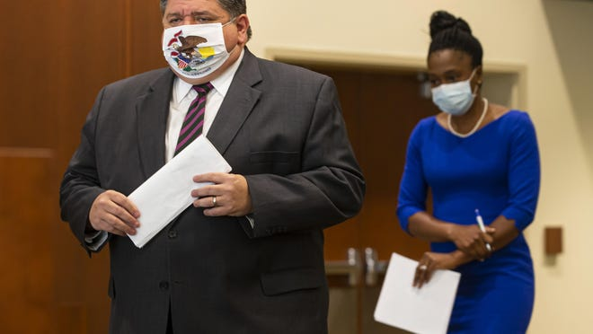 Illinois Gov. JB Pritzker walks out with IDPH Director Dr. Ngozi Ezike for a press conference at the Memorial Center for Learning and Innovation on Sept. 21, 2020, in Springfield.