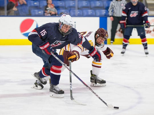 Joey Cassetti of the U.S. NTDP Under-18 team (15) races against an Arizona State University player for the puck during Friday's game.