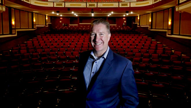 Kyle Westberg, co-owner of the Flagstar Strand Theatre for the Performing Arts in downtown Pontiac, on stage in the theater on Friday, May 4, 2018.