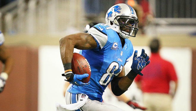 Detroit Lions wide receiver Calvin Johnson (81) runs the ball after the catch against the Atlanta Falcons during a game at Ford Field in Detroit on Dec. 12, 2012.