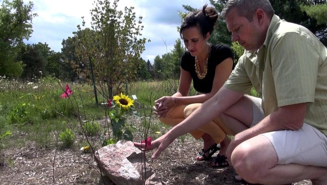 Dan and Michaela Cady visit the grave of their daughter Kennis, who died by suicide in 2015. The Cady's are suing the East Rochester school district for not doing enough to prevent bullying.