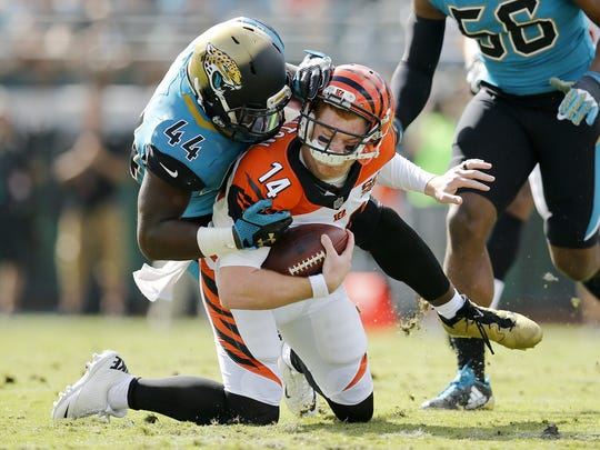Cincinnati Bengals quarterback Andy Dalton is brought down by Jacksonville Jaguars outside linebacker Myles Jack with no flag thrown in the first quarter of the Bengals' loss to to the Jaguars.