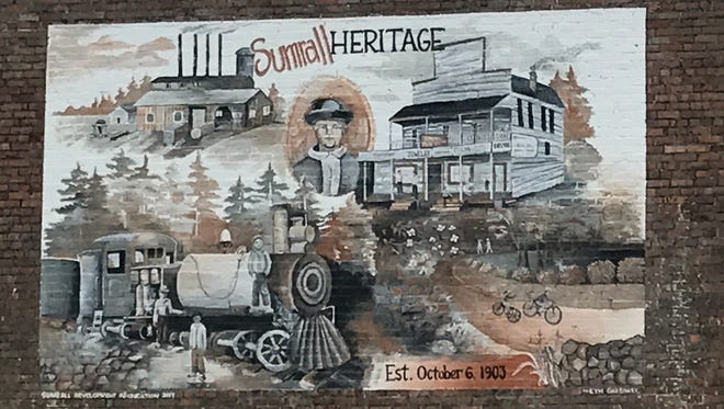 A mural showing Sumrall's heritage sits across from the town hall.