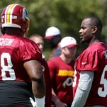 Washington defensive tackle Terrance Knighton, left, talks with newly signed teammate Junior Galette at training camp in Richmond on Friday.