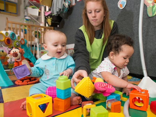 Emily Brink, an infant's teacher at KinderWorld, keeps