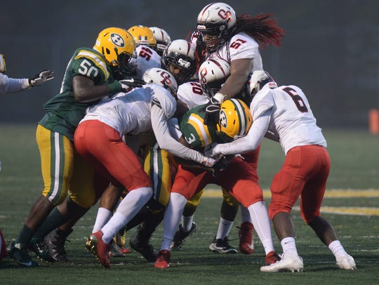 Harrison's Roderick Heard is stacked up by a host of