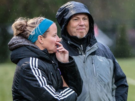 Oconomowoc head coach Laura Culhane talks strategy with assistant coach Todd Rohrer during the match at home against Hamilton in 2015.