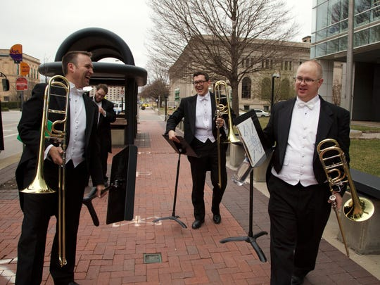"""Casey Maday (from left), Ravil """"Bo"""" Atlas, William Bakerand Dr. Bill Mann laugh as they come off the D-Line DART bus Friday, March 31, 2017, after playing for the Juice Side Sessions music series in downtown Des Moines."""