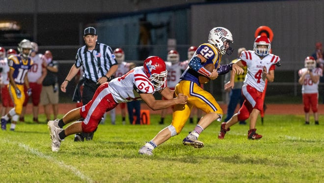 Dalton Hilyard breaks the tackle of a Marion defender in the 34-8 win over Marion on Friday, Sept. 11 at Douglass High School. Hilyard ran for 214 yards and three touchdowns in the win.