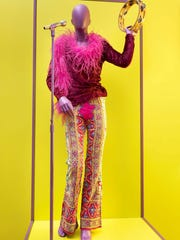 This is Janis Joplin's velvet top, bell bottoms, feather