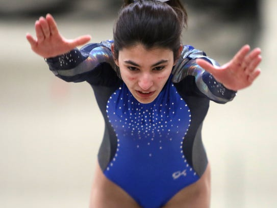 Brookfield's Amanda Pennow competes on the vault at