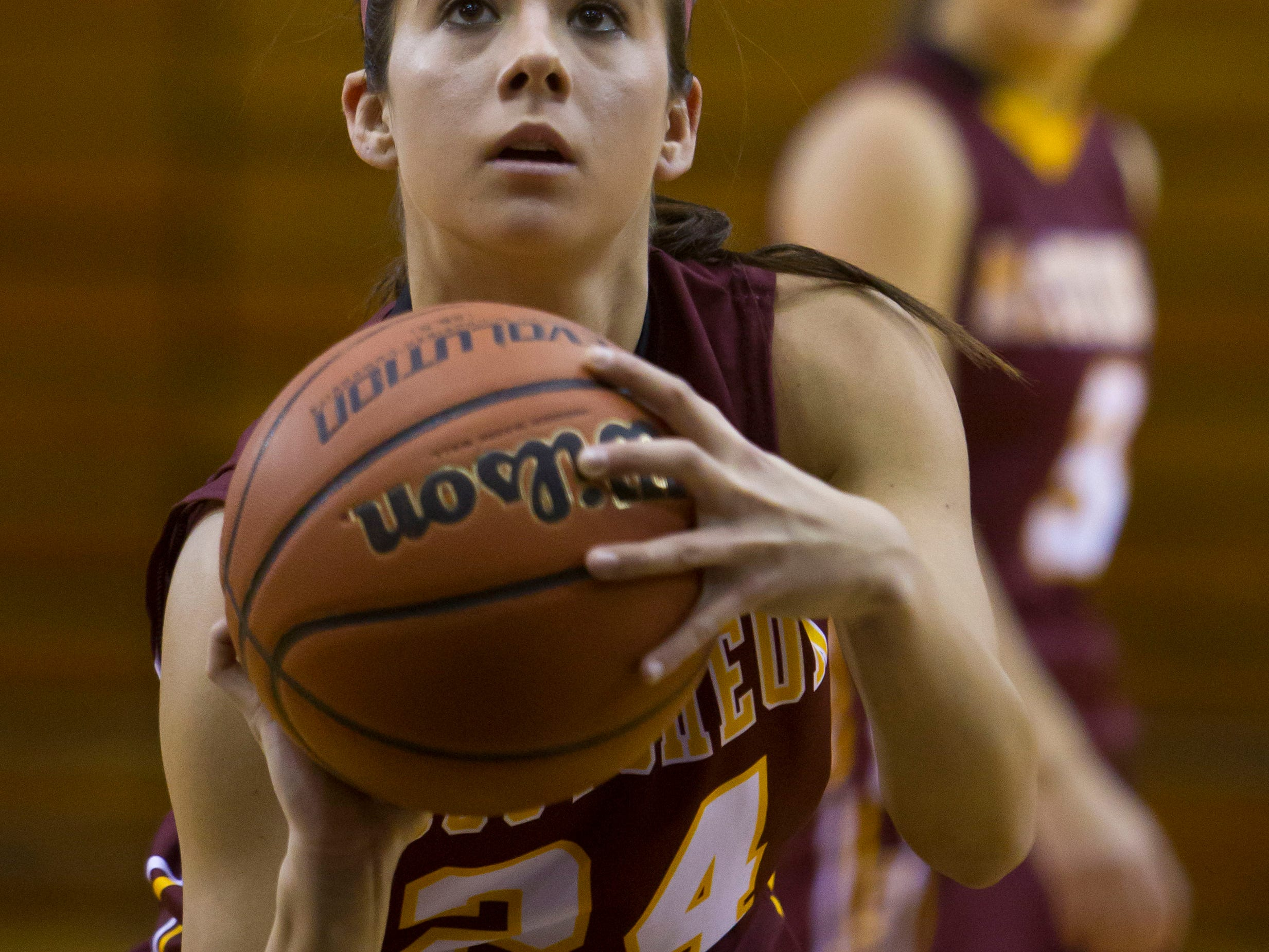 McCutcheon's Kerstyn Lowery, 24, eyes a free throw during their game against Lafayette Jeff Thursday, January 16, 2014, at Jeff High in Lafayette. McCutcheon won 56-40.