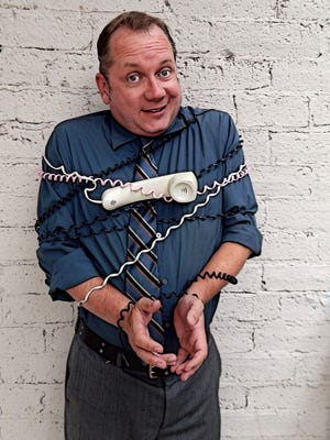 "Tom Chalmers gets tied up in phone conversations during ""Fully Committed"" at BMCA."