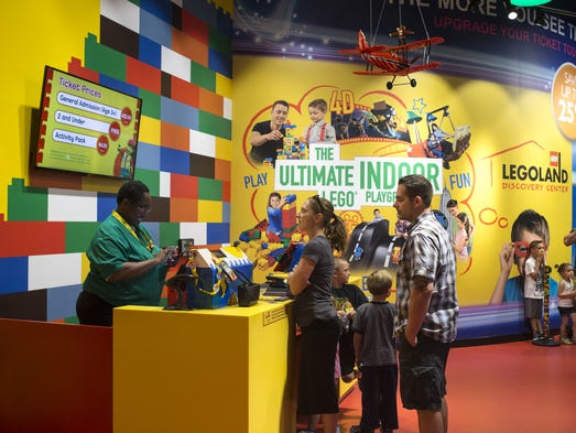 Customers check in April 22, 2016, at Legoland Discovery