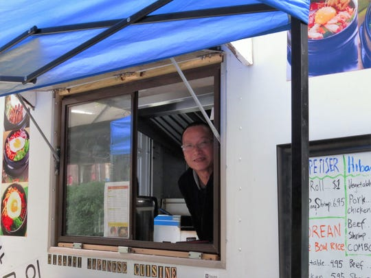 Chef Li in his new food truck, featuring Korean rice bowls and Japanese hibachi and teriyaki dishes.