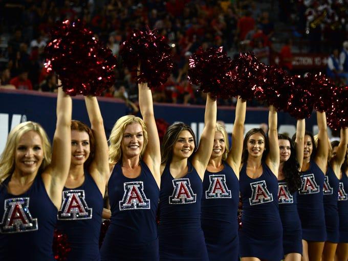 Arizona Wildcats cheerleaders perform against the Northern