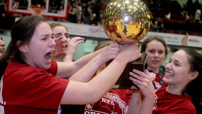 Rye celebrates after defeating Ursuline 63-47 to win the Section 1 Class A girls basketball championship at the Westchester County Center in White Plains Feb. 28, 2016.