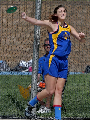 Sydney Laufenberg, of Clinton Prince of Peace of Clinton, won her second straight discus title in Class 1-A.