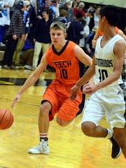 Beech High sophomore Ty Dean dribbles toward the basket