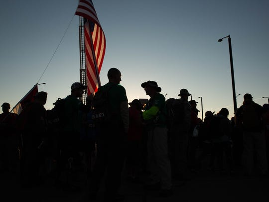 As the sun rises over White Sands Missile Range, the 28th annual Bataan Memorial Death March started, with the 7,200 participants lining up to walk past the eight survivors of the Bataan Death March greeting them and thanking them for their service, Sunday, March 19, 2017.