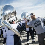 Band members high-five fans while marching to the Byrce Jordan Center on Saturday Sept. 26, 2015 at University Park.
