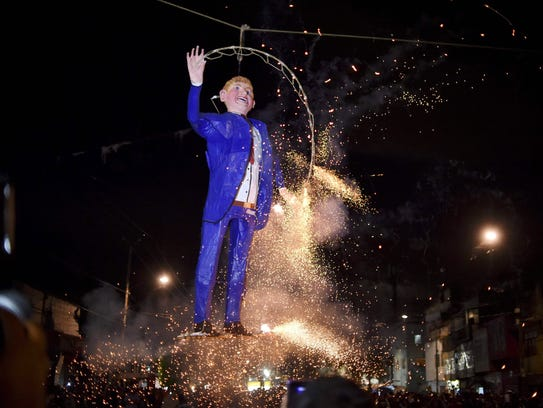 Mexicans set fire to an effigy of Donald Trump in Mexico