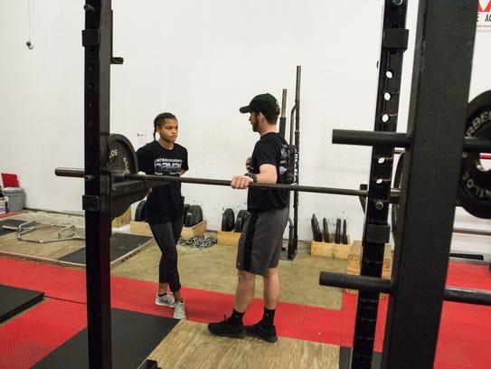 Wi-Hi sophomore Brianna Stevenson works trainer Cody