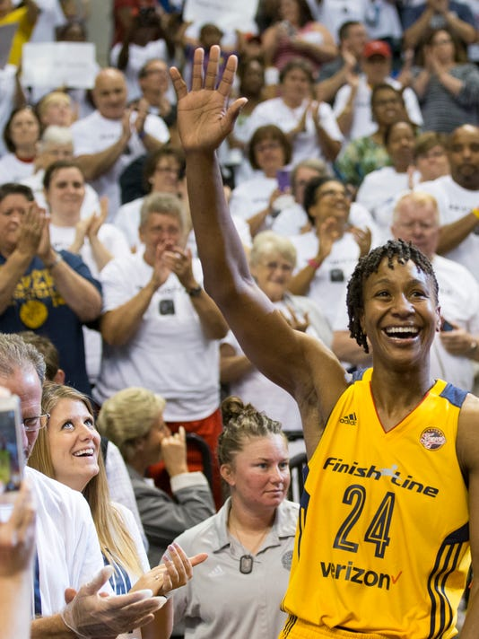 Indiana Fever's Tamika Catchings acknowledges the crowd during a WNBA basketball game against the Dallas Wings in Indianapolis, Sunday, Sept. 18, 2016. Catchings scored 16 points in her final regular-season WNBA game and the Indiana Fever locked up the No. 5 playoff seed with 83-60 victory over the Dallas Wings. (Robert Scheer/The Indianapolis Star via AP)
