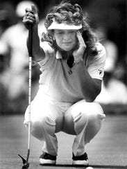 Judy Dickinson lines up a putt during her victory at