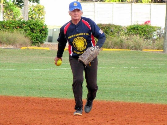 American Legion Post Fuzz Fazekas tosses the ball for a force out at second base against Kirk's Coney Island.