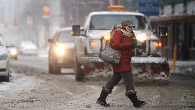 A bundled up pedestrian braves below zero temperatures in Rochester earlier this year.