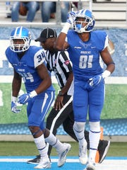 MTSU's CJ Windham (81) and Tyshawn Brown celebrate Windham's 2 point conversion against UTSA on Saturday, Nov. 5, 2016.