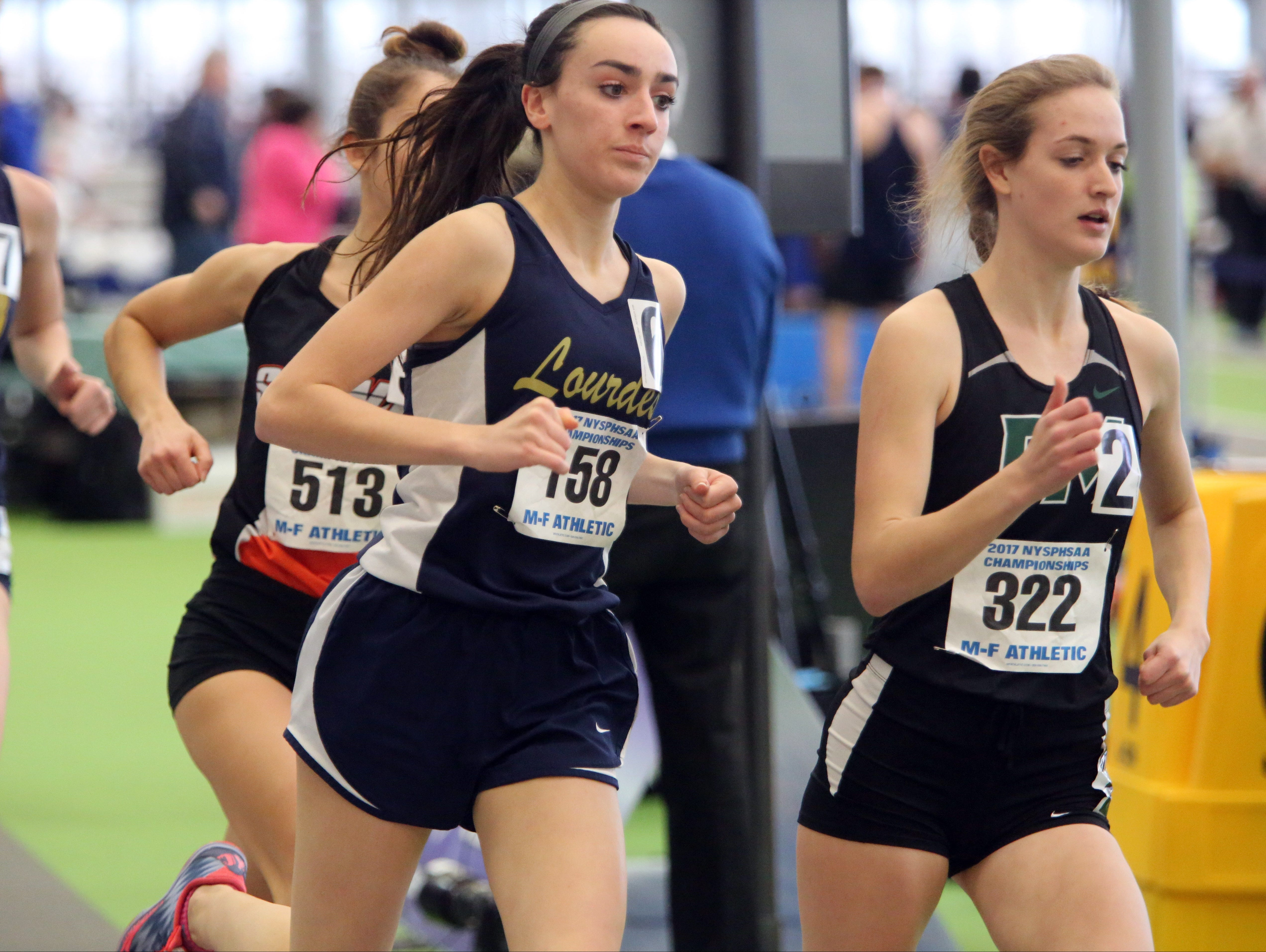 Caroline Timm from Lourdes competes in the girls 1,500 meter run during the NYSPHSAA Track and Field championships at the Ocean Breeze Athletic Complex in Staten Island, March 4, 2017.