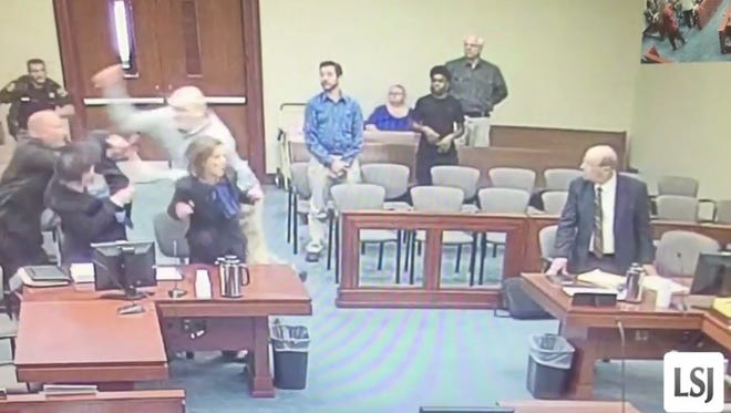A screenshot of the video that shows In the video, Joshua Harding targeting tried to stab assistant prosecutor Jonathan Roth, specifically, running passed another assistant prosecutor to get to Roth.