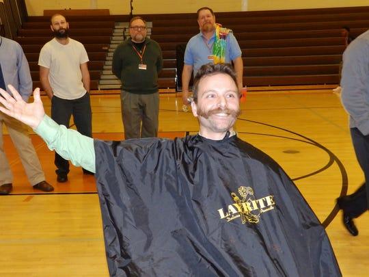 "Brett Severino, a Cumberland Regional High School teacher and organizer of the school's Janu-HAIRY fundraiser, reveals his new ""Super Mario"" mustache."
