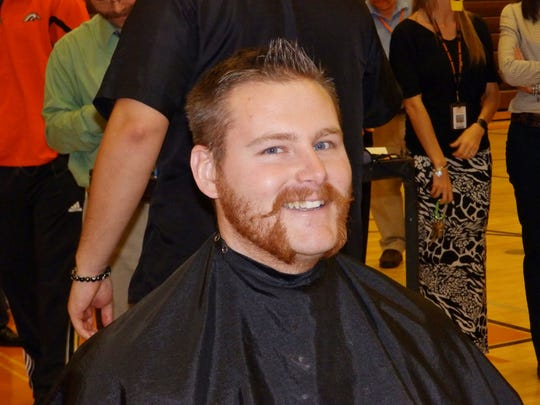 """Eugene Thomas, a Cumberland Regional High School teacher who participated in the Janu-HAIRY fundraiser, displays his """"Friendly Mutton Chops"""" look."""