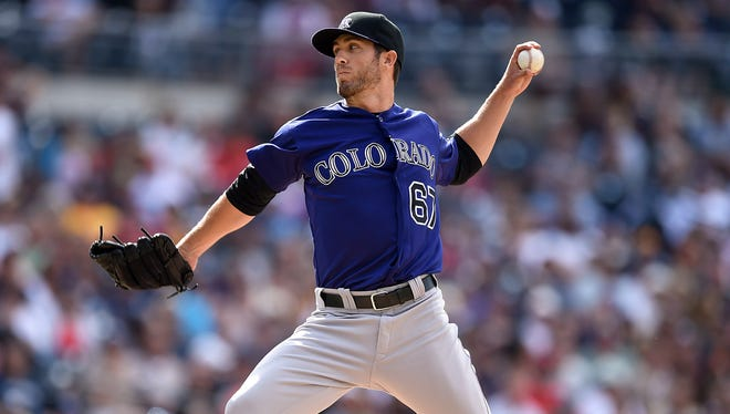 Ken Roberts pitches for the Colorado Rockies against the San Diego Padres.