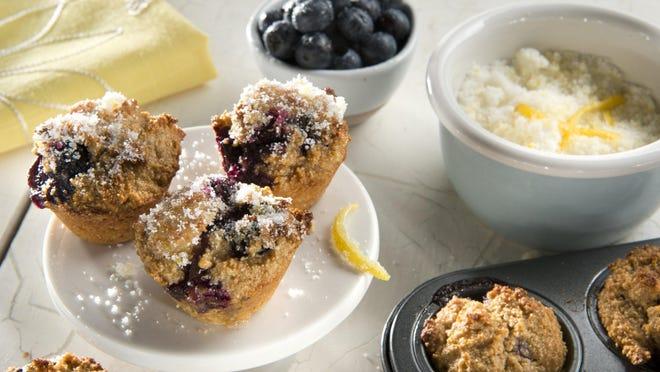 Mini lemon glazed blueberry muffins.