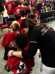 Diana Hosford of TAPS with the  children of fallen