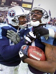 "Yancey Thigpen, left, congratulates Titans wide receiver Kevin Dyson, who scored on the ""Music City Miracle"" with seconds to play in a 2000 playoff game against Buffalo."
