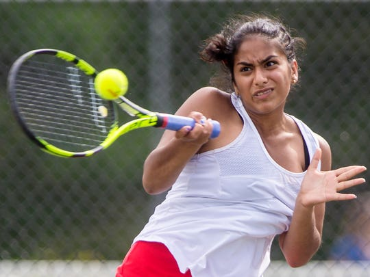 CVU's Stephanie Joseph returns the ball against South Burlington's Sajani Sivakumar in last year's tennis championship match at Davis Park.