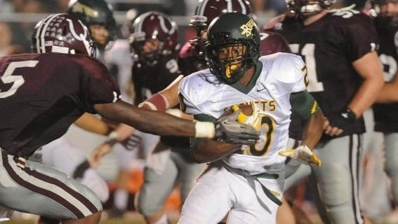 Reynolds' A.J. Logan (20) carries the ball during the Rockets' 2013 game against Owen.
