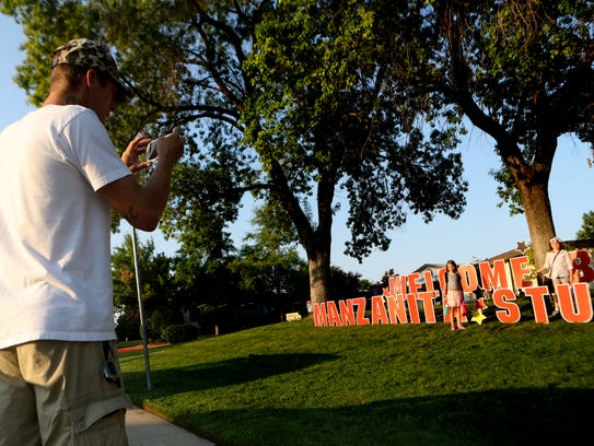 Jon Saterstad takes a picture of his kids Summer, 7,
