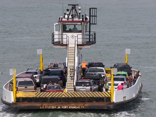 A ferry carries passengers and their vehicles across
