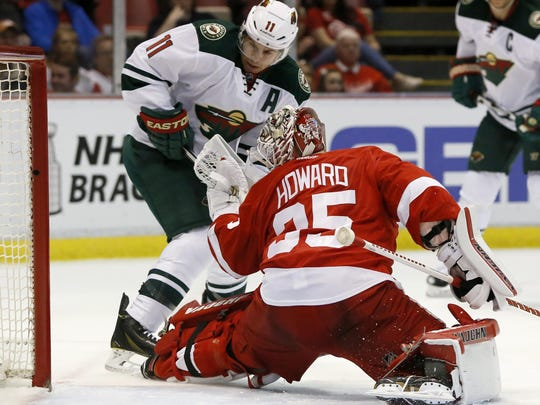 The Minnesota Wild's Zach Parise (11) tries to take a shot on goal against the Detroit Red Wings' Jimmy Howard (35) during the first period on April 1 in Detroit.