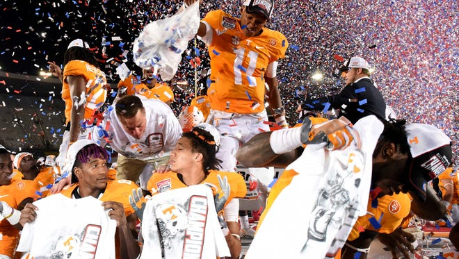 Tennessee quarterback Joshua Dobbs (11) dumps confetti over his Tennessee teammates as they celebrate their 45-24 win over Virginia Tech at The Battle At Bristol on Sept. 10, 2016.