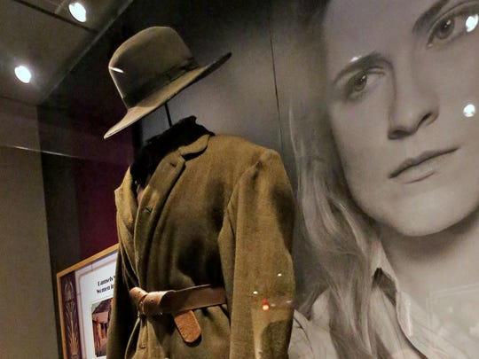 """This is the costume worn by Hailee Steinfeld, as Mattie Ross, in the Paramount Pictures 2010 re-make of the movie, """"True Grit,"""" and it is seen in The Reel West exhibit at the Eiteljorg Museum, Thursday, March 1, 2018.  The exhibit, which runs Mar. 3, 2018 to Feb. 3, 2019, looks at """"morality, diversity, and American identity,"""" seen through the Western film genre, Hollywood movies, and television shows."""