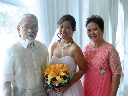 Boots Lambrecht, center, with her parents on her wedding day in Antipolo City, Philippines.