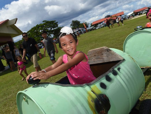 Lei'lah Debita, 4, takes a ride during the Government